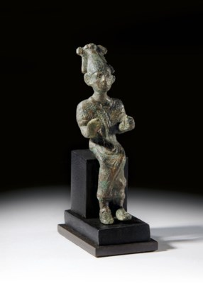 A SYRO-EGYPTIAN BRONZE FIGURE