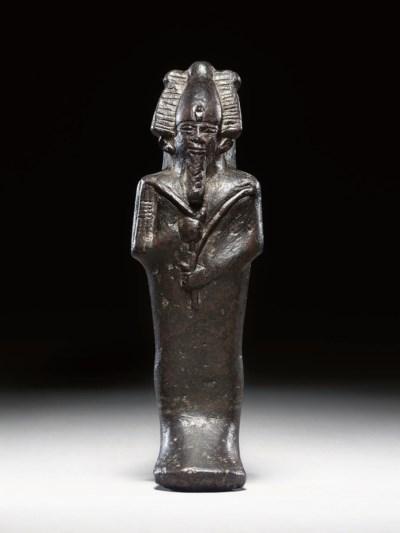 AN EGYPTIAN SERPENTINE FIGURE