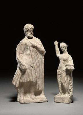 A GREEK TERRACOTTA FEMALE FIGU