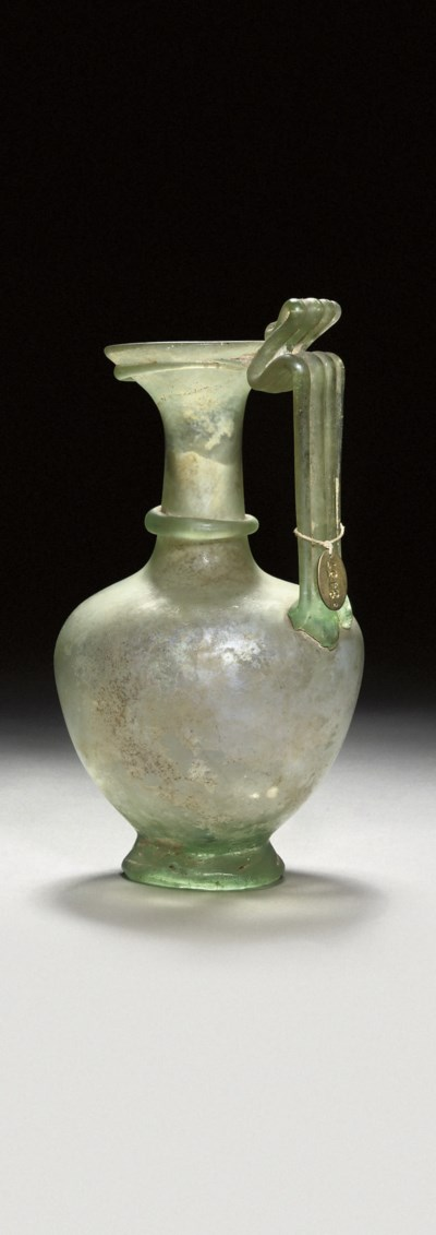 A ROMAN GREEN GLASS JUG