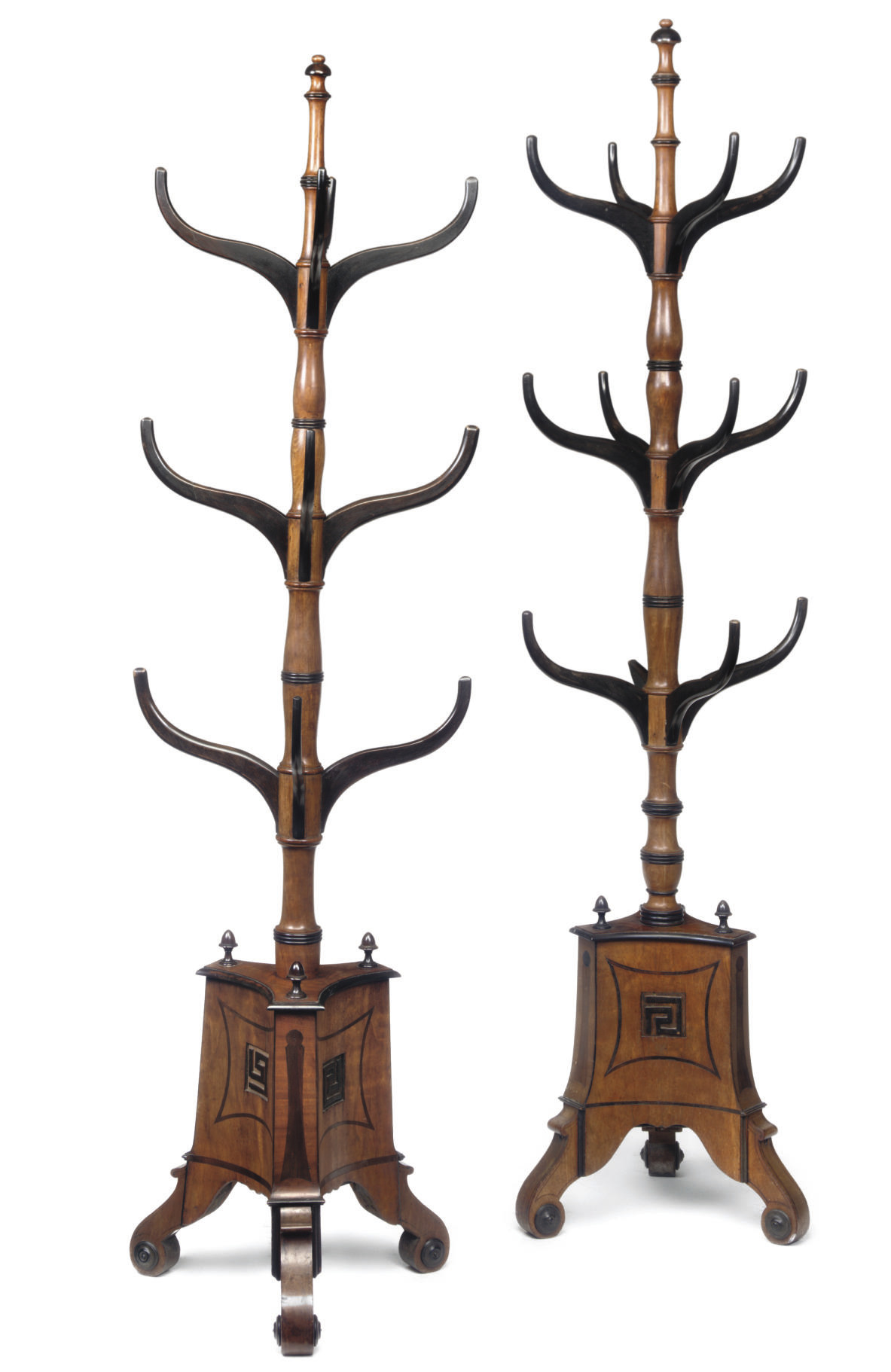 A NEAR PAIR OF REGENCY MAHOGANY AND EBONISED HALL STANDS