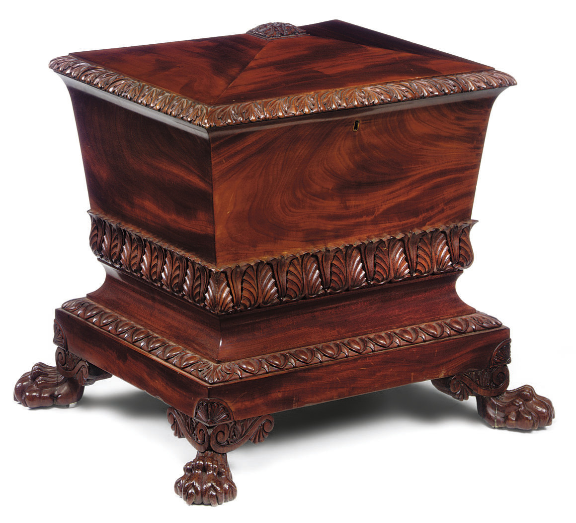 A GEORGE IV CARVED MAHOGANY WI