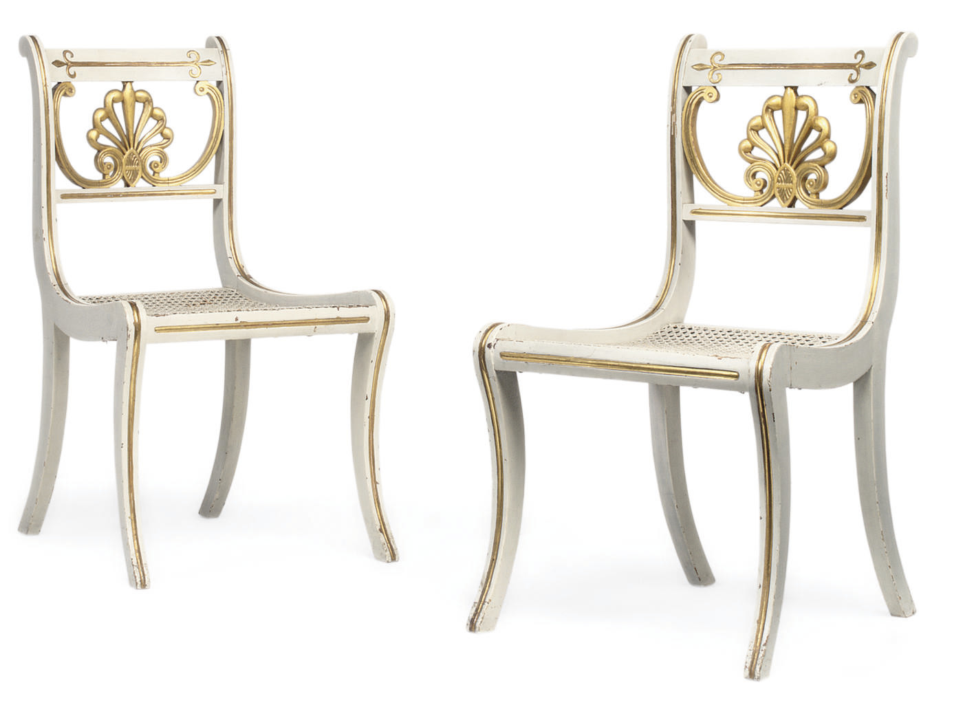 A PAIR OF SCOTTISH GEORGE IV WHITE-PAINTED AND PARCEL-GILT DINING CHAIRS