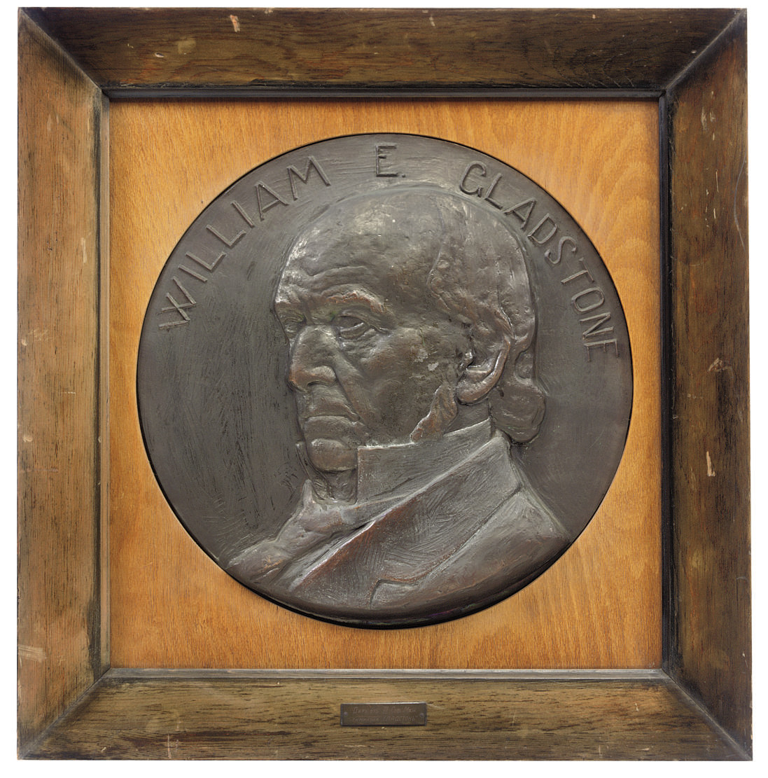 A BRONZED METAL PLAQUE OF WILL