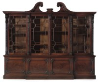 A GEORGE III MAHOGANY BREAKFRONT BOOKCASE