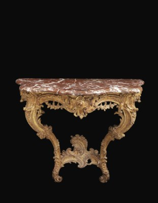 A LOUIS XV CARVED GILTWOOD SER