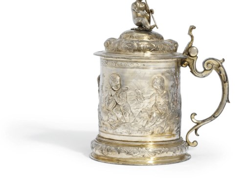 A SILVER-PLATED TANKARD