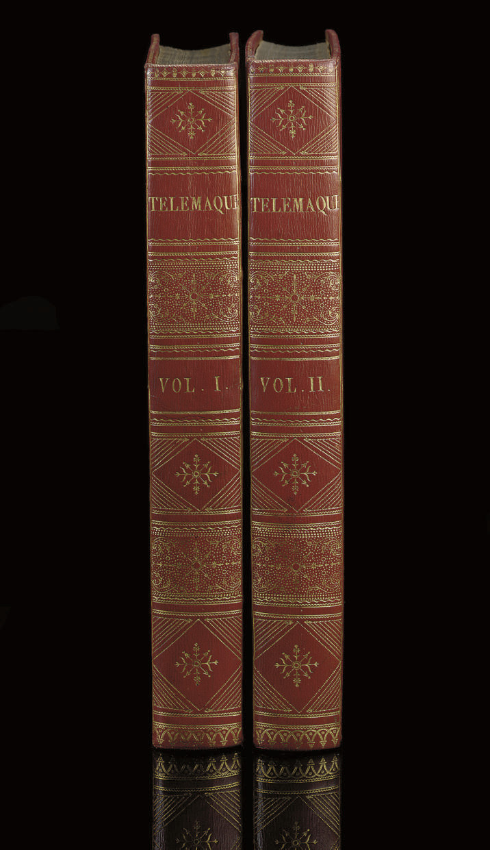 FENELON, François de Salignac de la Mothe (1651-1715).  Les aventures de Télémaque. Paris: de l'imprimerie de Monseiur, chez Didot, Barrois, Onfroy, Barrois and Delaine jeune, 1785. 2 volumes, 4° (327 x 240mm).  Half titles, additional engraved title by Montulay in volume I,  72 plates by Tilliard after Monnet and 24 engraved summaries (light browning or spotting, a little stronger in vol.II, occasional marginal offsetting). Contemporary red morocco gilt, roll-tool border on sides, inner dentelles, silk endpapers, flat spines ruled and elaborately tooled gilt in compartments, title on spines, gilt edges (spines very lightly sunfaded, small old repair on front cover of vol.I). Provenance: René Choppin (bookplate)  -- Florencio Gavito (20th-century Mexican bibliophile, bookplate).  Brunet II, 1215; Cohen-de-Ricci 384-85.
