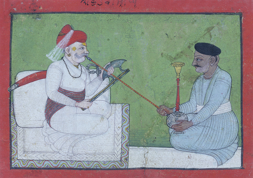 A NOBLE SMOKING A PIPE, MEWAR