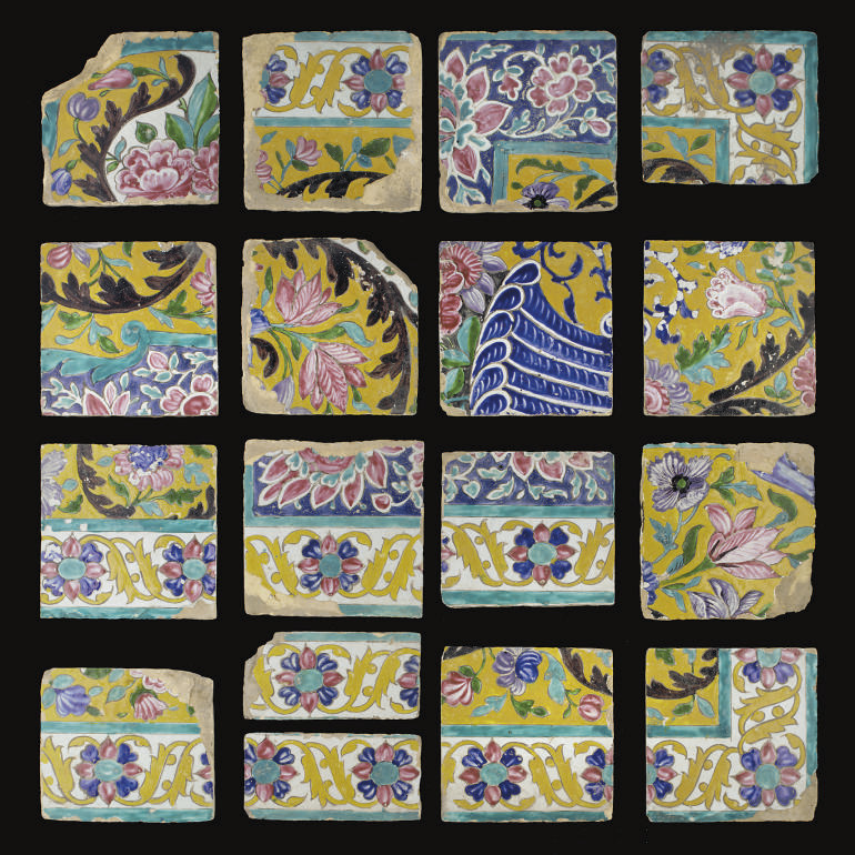 A GROUP OF QAJAR TILES FROM A