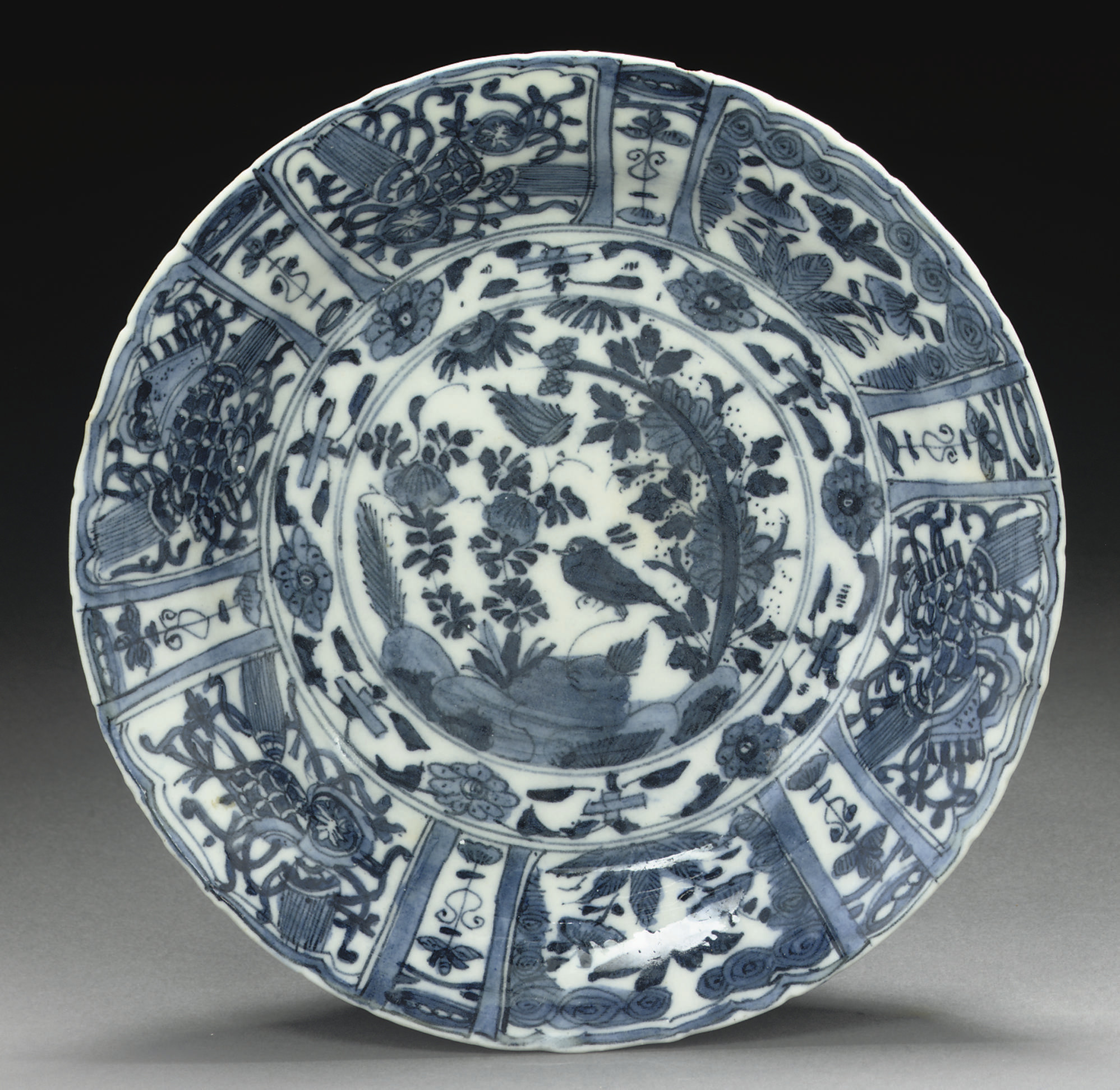 A SAFAVID BLUE AND WHITE DISH,