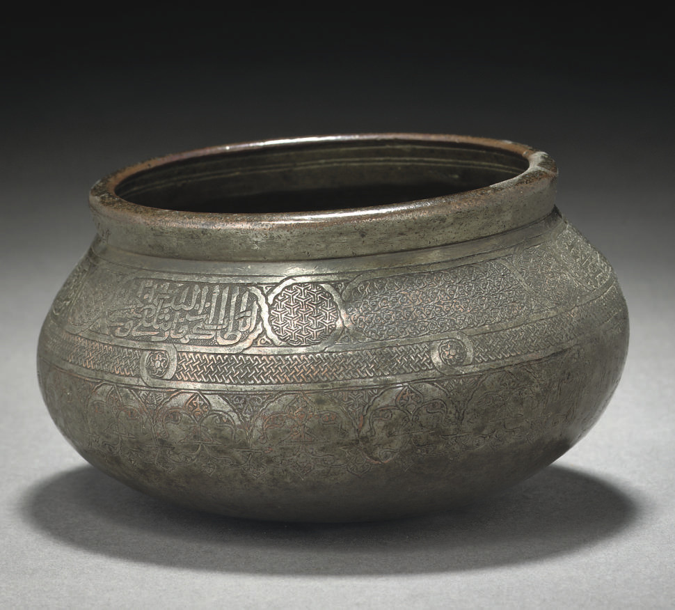 A MAMLUK TINNED COPPER ENGRAVE