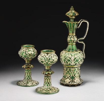A BOHEMIAN GREEN GLASS EWER AN