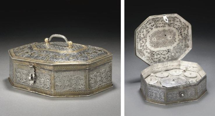 A CAST SILVER AND GILT PANDAN