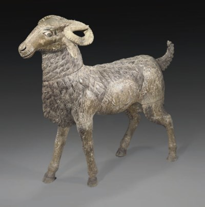 A KASHMIRI CARVED WOOD GOAT, I