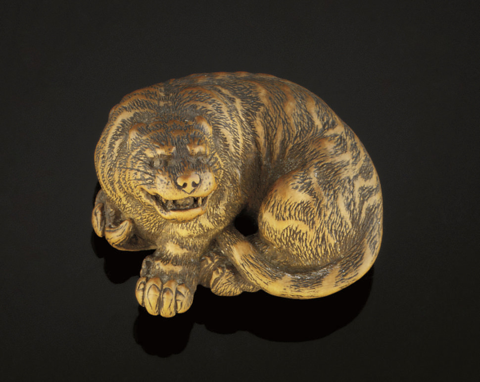 A wood model of a tiger, signe