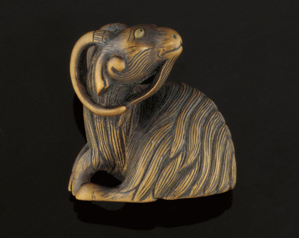 A wood model of a goat, signed