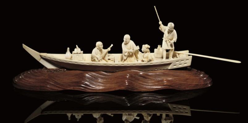 An ivory okimono of a pleasure