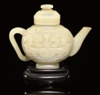 A white jade ewer and cover, 1