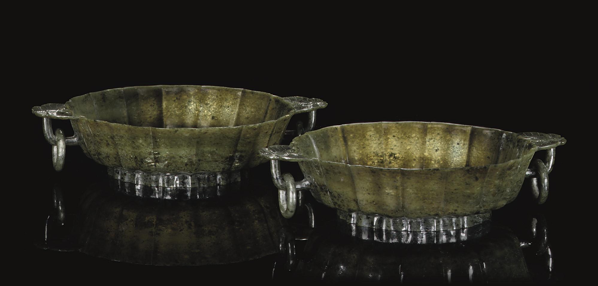 A pair of spinach jade bowls,