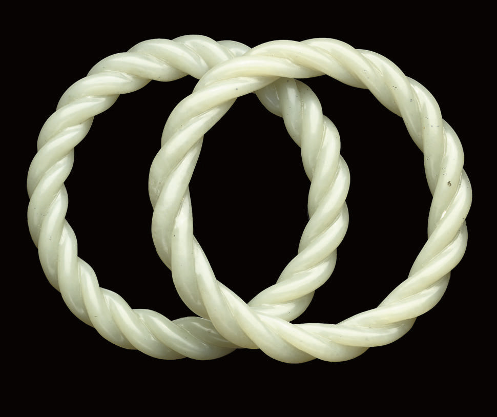 A pair of Pale celadon rope-tw