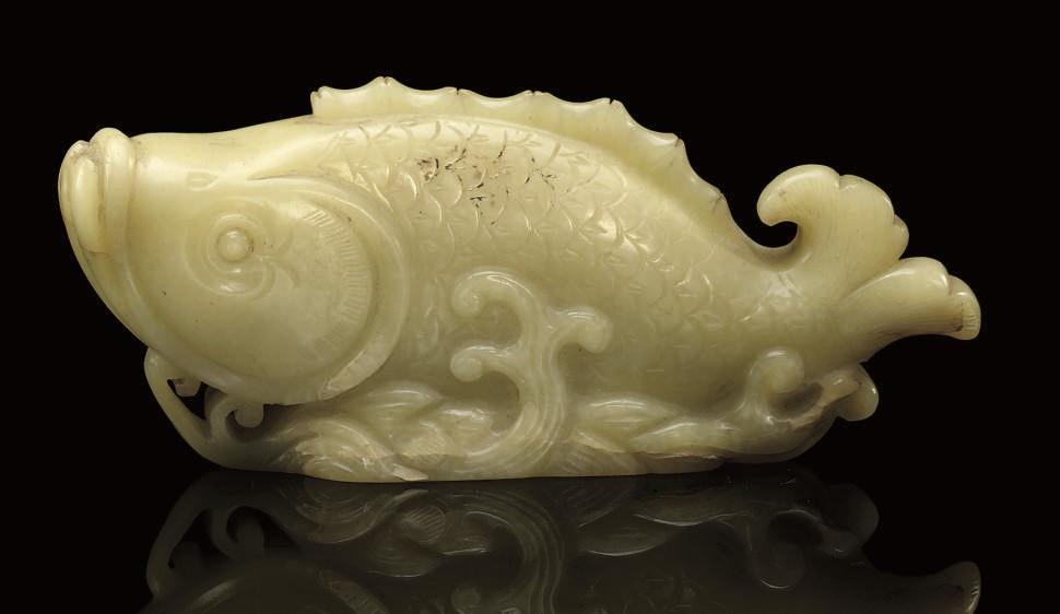 A YELLOW JADE MODEL OF A CARP,