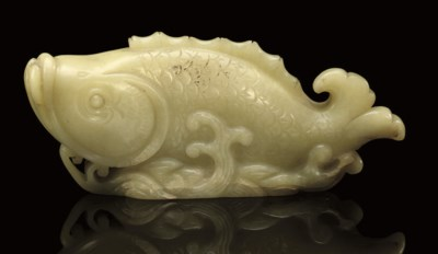 A YELLOW JADE MODEL OF A CARP,