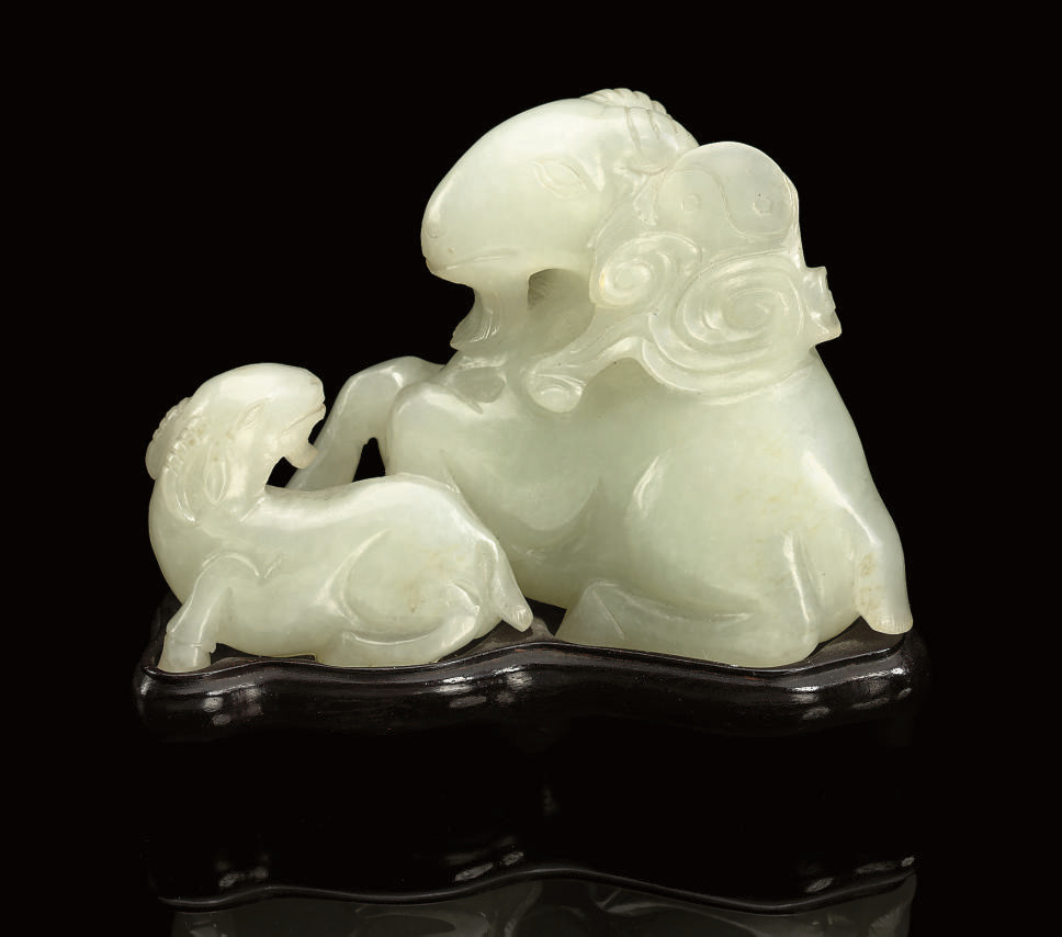 A PALE CELADON JADE RAM GROUP,