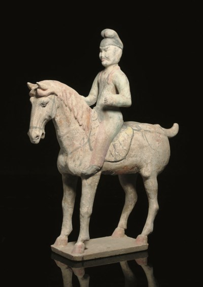 A painted pottery horse and ri