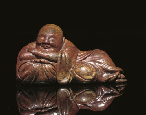 A Soapstone model of a sleepin