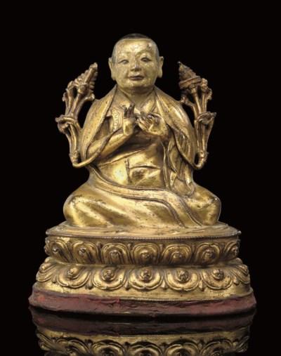 A Tibetan gilt bronze model of