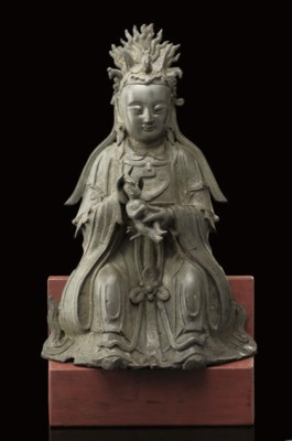 A bronze model of Guanyin and