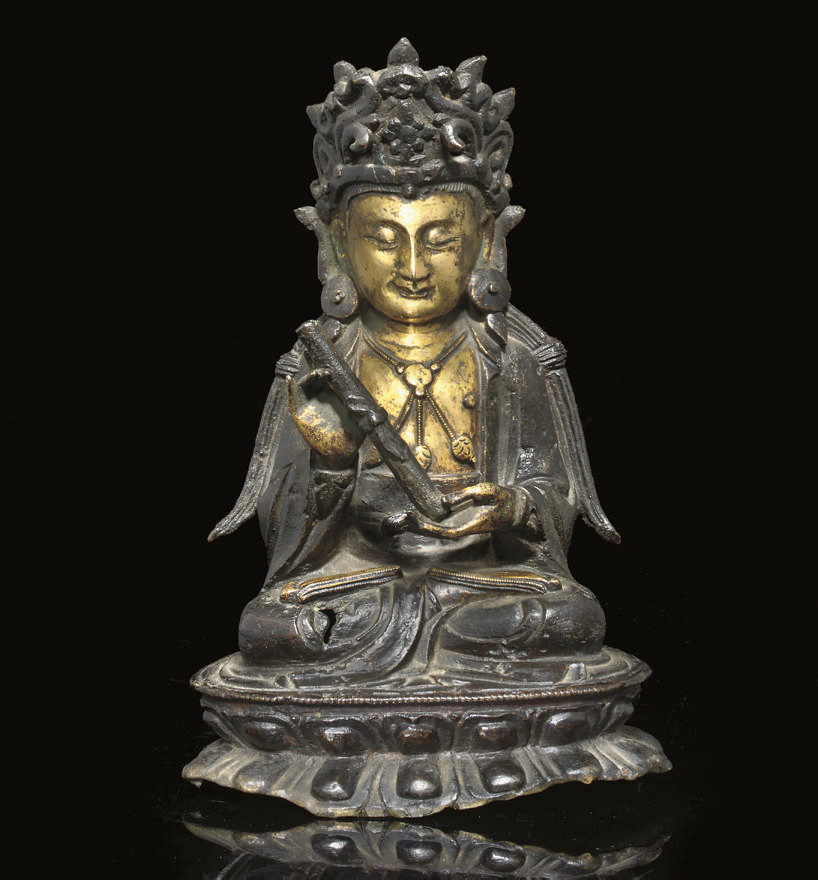 A gilt bronze model of a bodhi