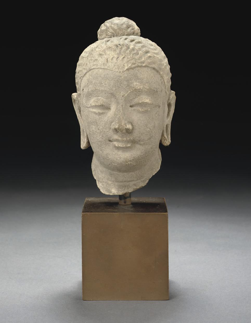 A STONE MODEL OF A HEAD, GANDH