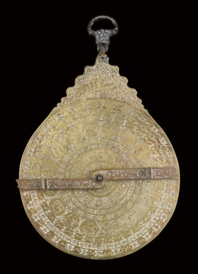 A LARGE QAJAR ENGRAVED BRASS A