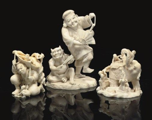 A group of three ivory okimono