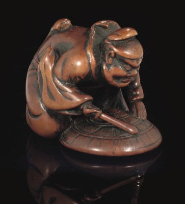 A wood netsuke of the Demon qu