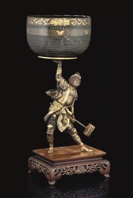 A Gilt Bronze Figure with a Pr