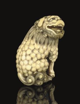 An ivory Netsuke of a Shishi,