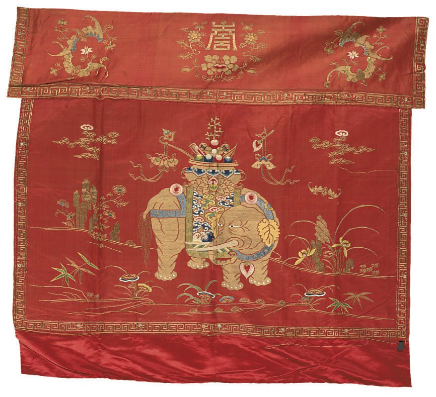 AN ALTAR FRONTAL OF RED SILK