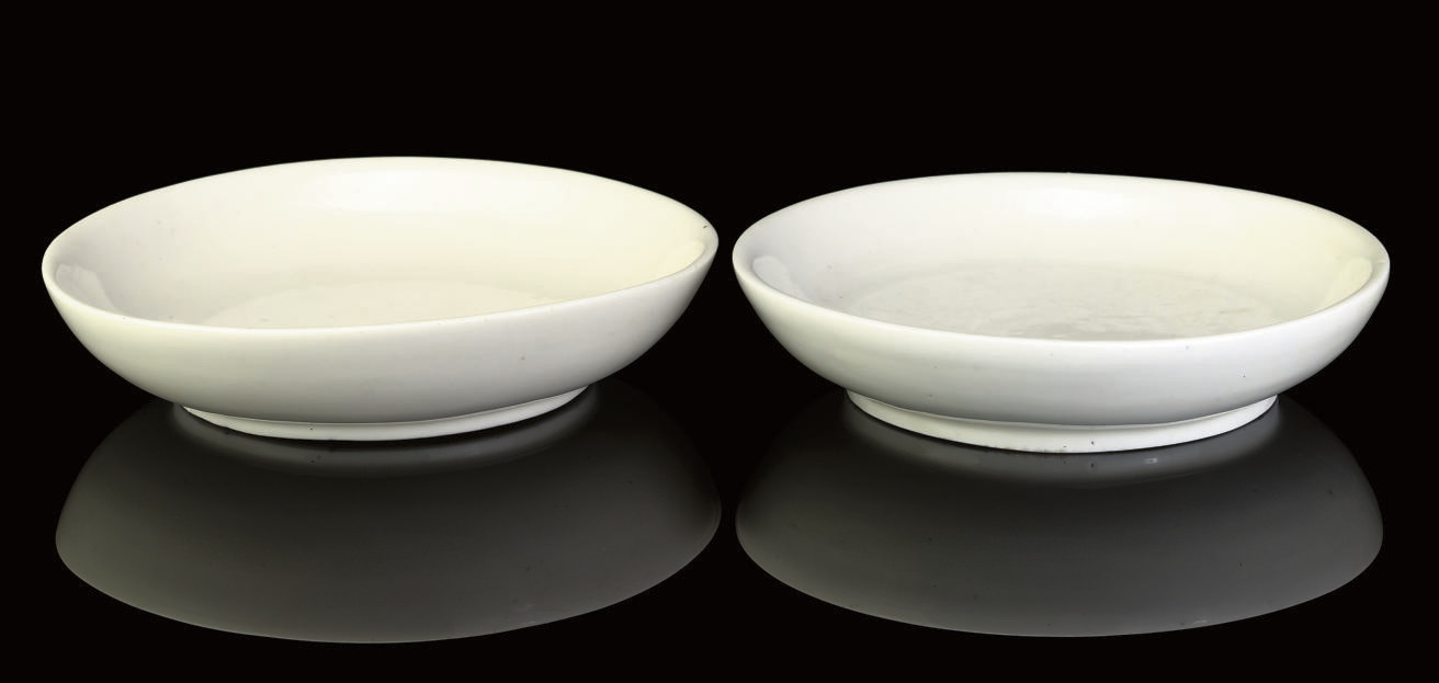 A PAIR OF BLANC-DE-CHINE DISHE
