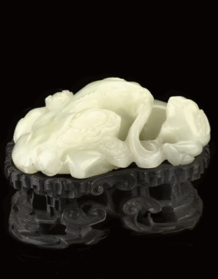A WHITE JADE MODEL OF A GOAT G