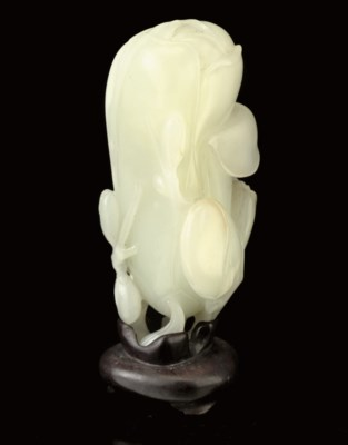 A WHITE JADE MODEL OF A MAGNOL
