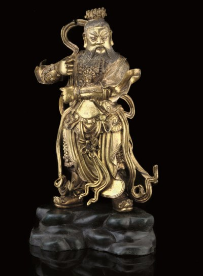 A GILT BRONZE MODEL OF GUANDI,