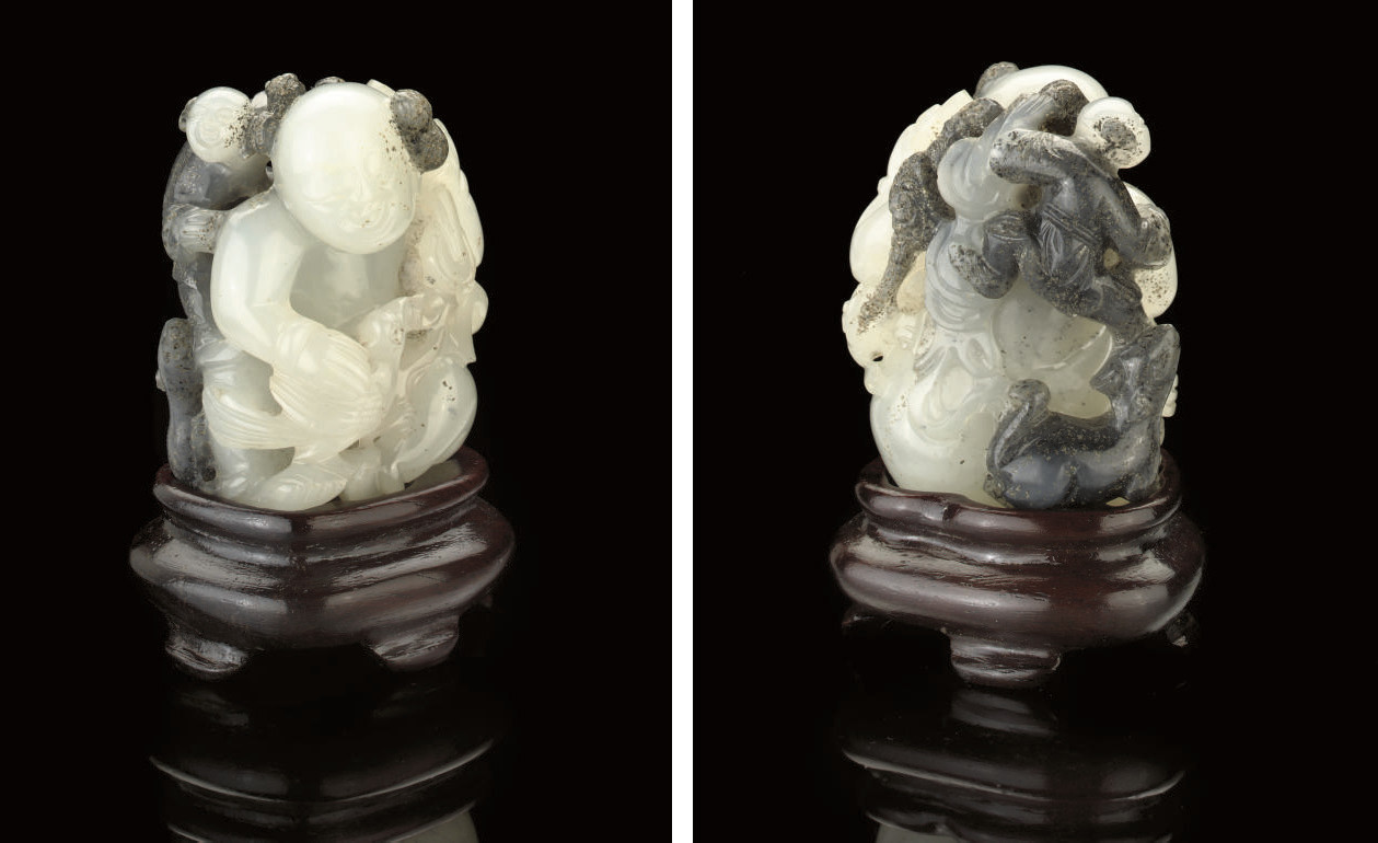 A TWO TONED GREY JADE CARVING