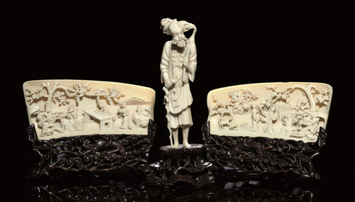 A PAIR OF CARVED IVORY WRISTRE