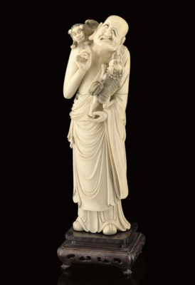 AN IVORY CARVING OF AN IMMORTA