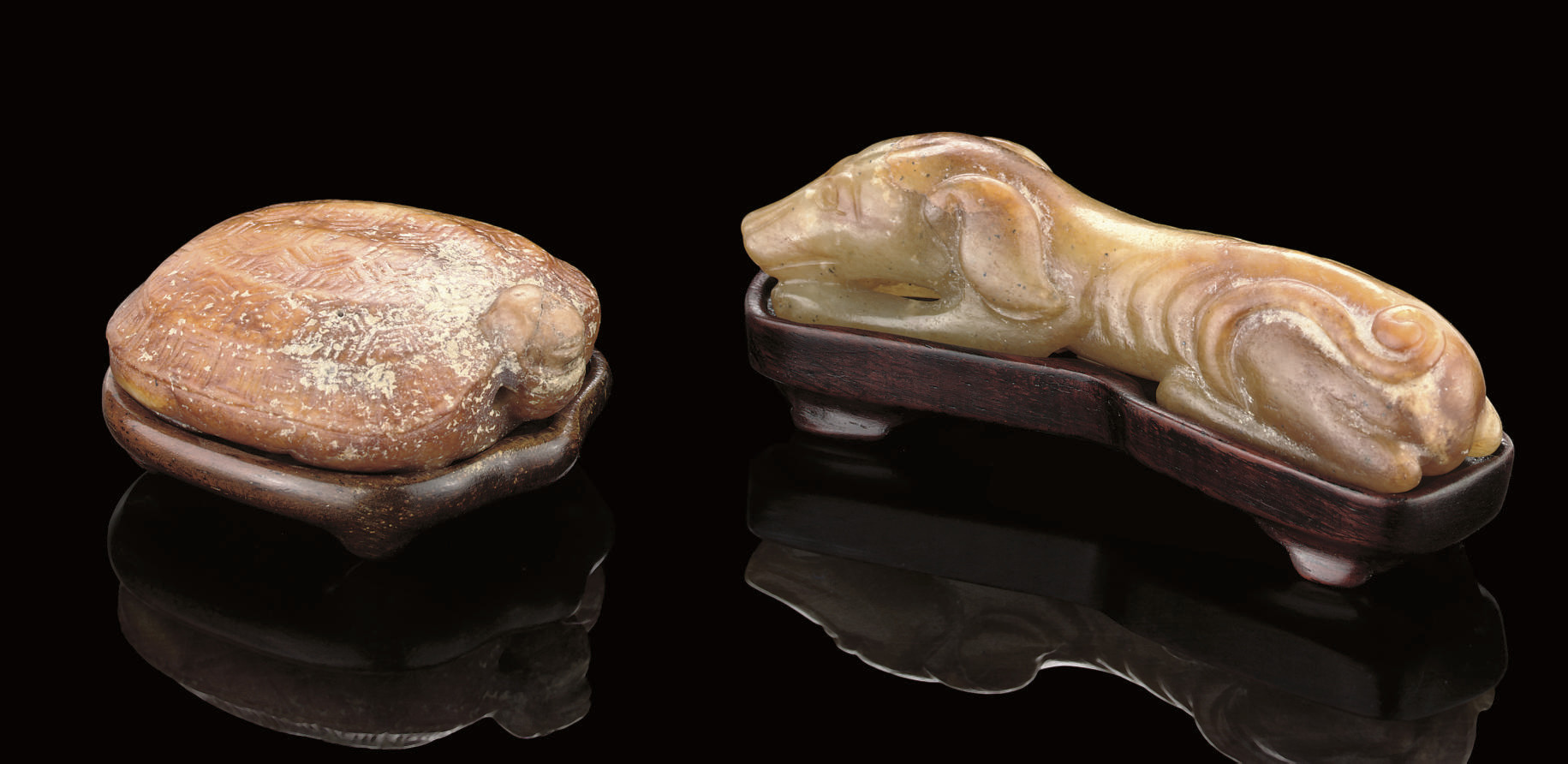 A CELADON AND RUSSET JADE CARV
