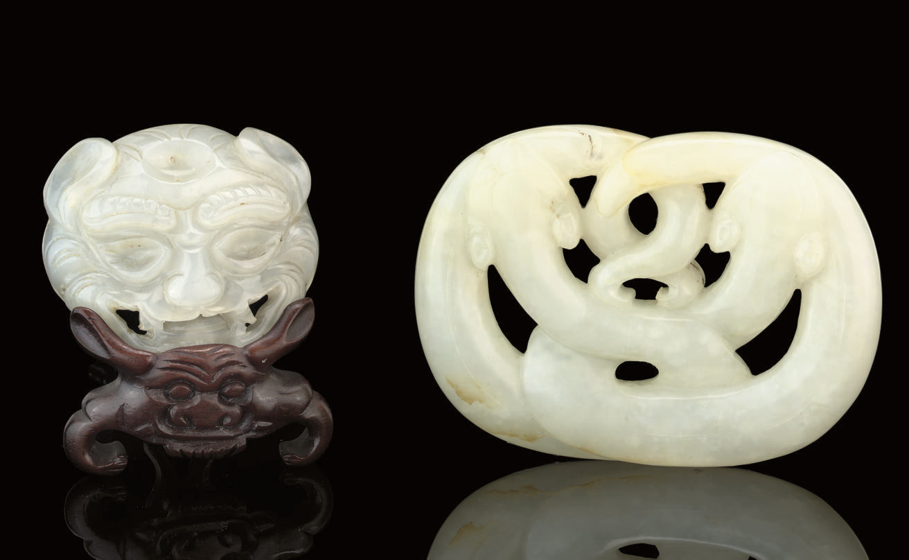 A WHITE JADE DRAGON PLAQUE, 17