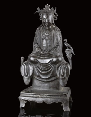 A BRONZE MODEL OF A SEATED BUD